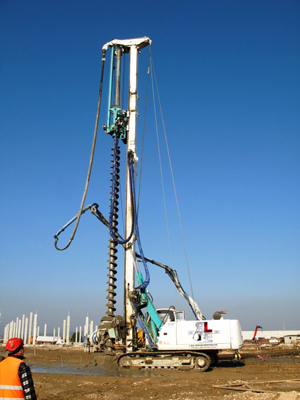 Auger Cast Installation by Auger Rig