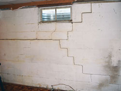 Montreal Basement Wall with Cracks and Inward Buckling