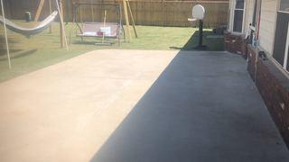 Sinking concrete patio repaired with PolyLevel® concrete lifting