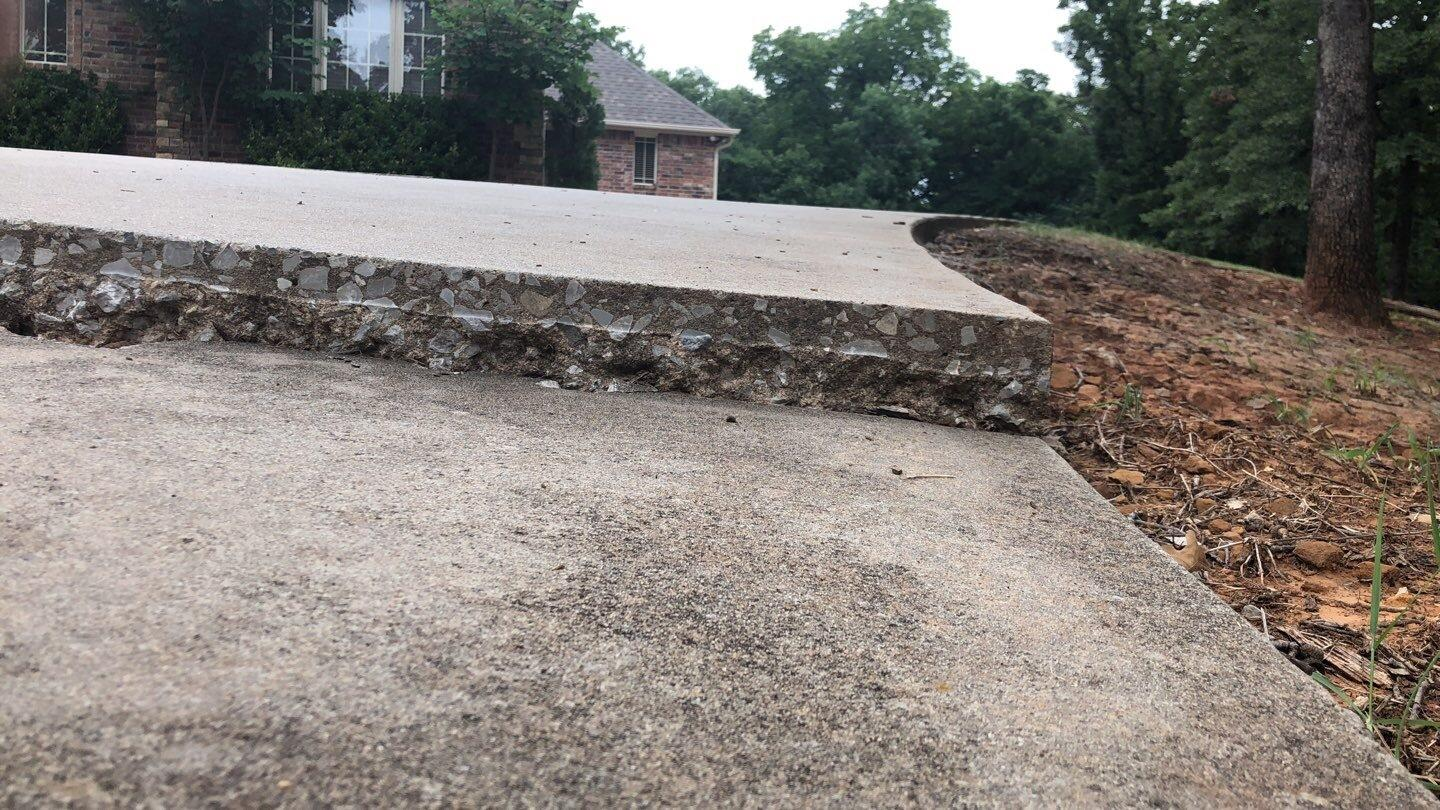 Concrete driveway cracking and sinking