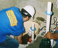 Installing a sump pump and backup sump pump system in IA