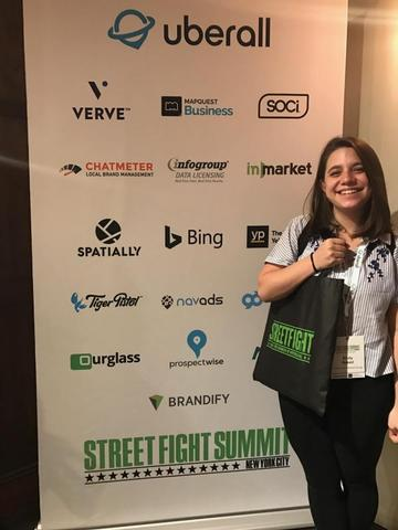 One of the Treehouse team members takes a photo at the Street Fight Summit
