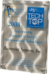 Basement Systems awarded with plaque at awards ceremony for being in Tech Top 40....