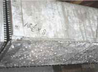 Droplets of condensation form on galvanized duct work